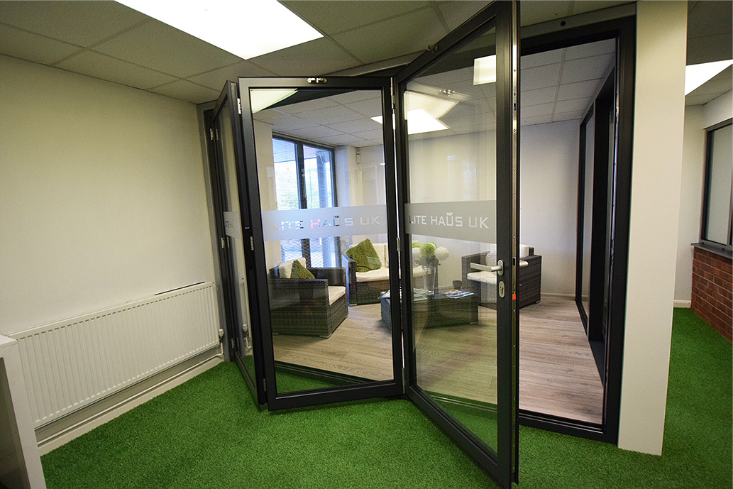 Aluminium folding doors with Lite Haus UK logo on the glass