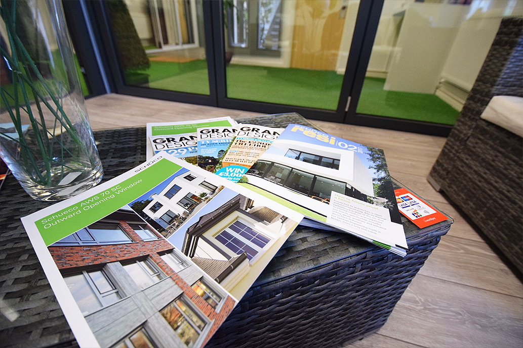 Grand Designs magazines on a table in a showroom