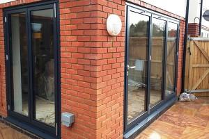Home installation of a 2 panel bifold door and a 3 panel bifold door