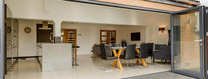 Fully opened bi-folding doors remove a wall of the house