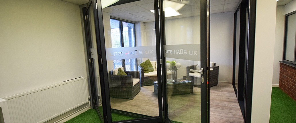 Aluminium folding doors with Lite Haus UK logo on the glass