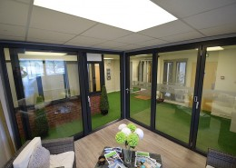 Schuco bifold door designed with an access leaf