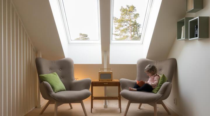 child reading underneath a skylight